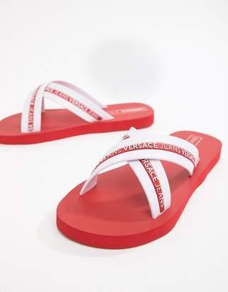 Versace Logo Cross Over Flip Flops In Red