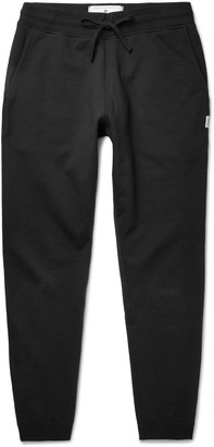 Reigning Champ Slim-Fit Tapered Cotton-Jersey Sweatpants $140 thestylecure.com