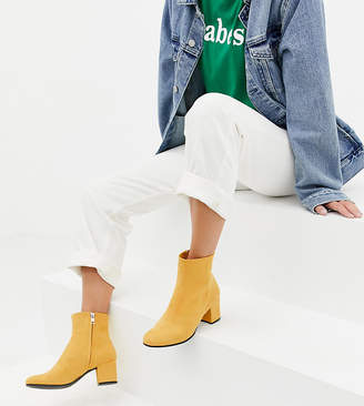 Monki faux suede heeled ankle boots in yellow