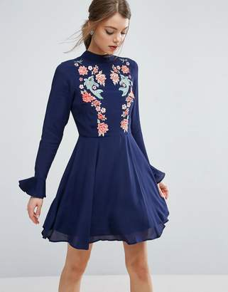 ASOS Embroidered Trumpet Sleeve Mini Dress $83 thestylecure.com