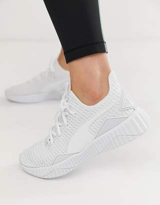 Puma defy sneakers in white