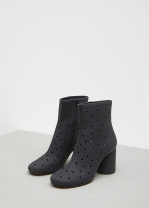 Maison Margiela black perforated leather mid ankle bootie $985 thestylecure.com