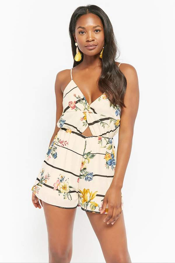 541f8172325c A woven romper featuring an allover floral and striped pattern