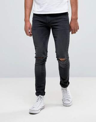 Asos DESIGN Super Skinny Jeans With Knee Rips In Dark Gray Wash