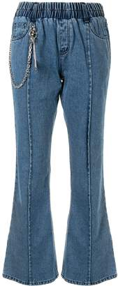 Pony Stone chain linked flared jeans