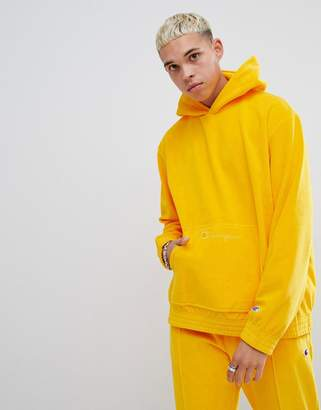 Champion velour oversized hoodie with small script logo in yellow