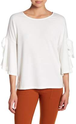 Pleione Bow Bell Sleeve Blouse