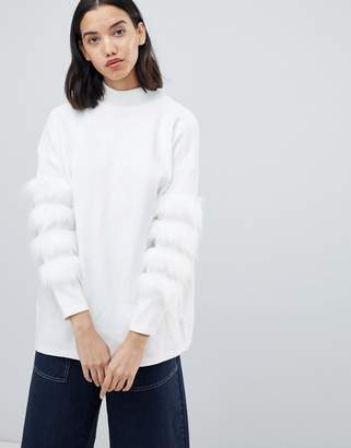 Amy Lynn high neck sweater with fur sleeve trim detail