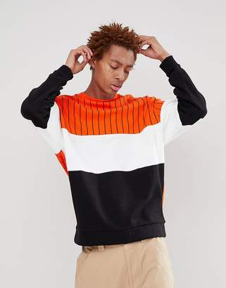 Asos DESIGN oversized sweatshirt with color block stripes