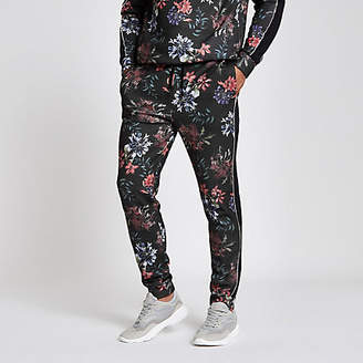 River Island Black floral print slim fit piped joggers