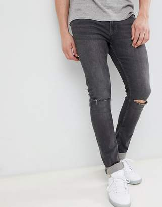 Jack and Jones skinny jeans with rip knee in dark gray denim