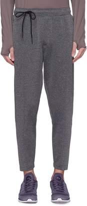 SIKI IM CROSS Reflective trim jogging pants