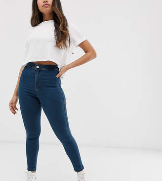 Asos DESIGN Petite Rivington high waisted denim jeggings in flat mid wash blue