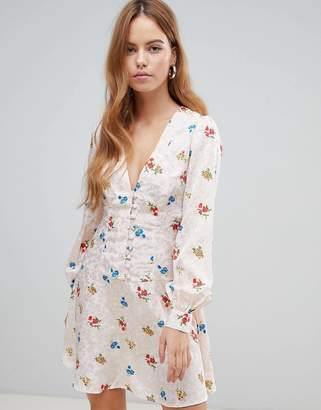 Asos DESIGN button through mini tea dress with long sleeves in floral jacquard