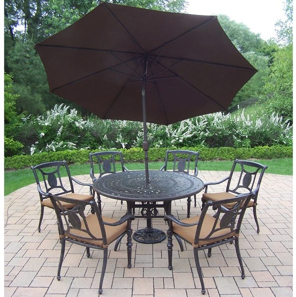 Oakland Living Corporation Sunbrella Aluminum 9-piece Dining Set includes 54-inch Table, 6 Stackable Chairs with Sunbrella Cushions, Umbrella, and Stand