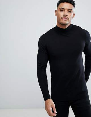 Asos DESIGN cotton turtleneck sweater in black