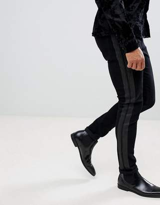 Asos DESIGN super skinny jeans in black with printed side stripe