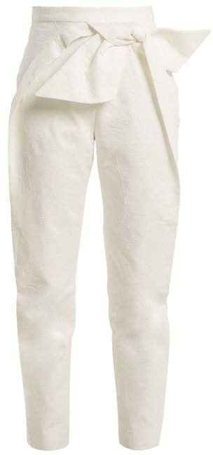Bow-detail high-rise tapered-leg cotton trousers