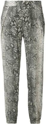 Gold Hawk snake-print trousers