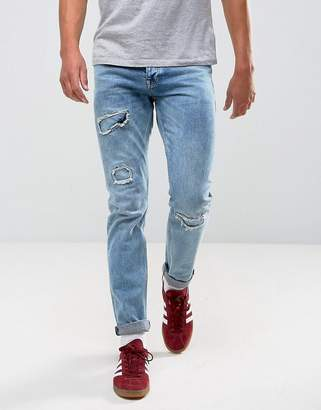 Asos DESIGN Slim Jeans In Vintage Mid Wash Blue With Rip And Repair