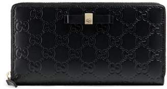 Gucci Bow Signature zip around wallet