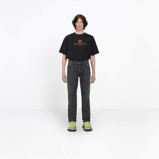 Balenciaga Straight leg jeans with hand made ripped knee