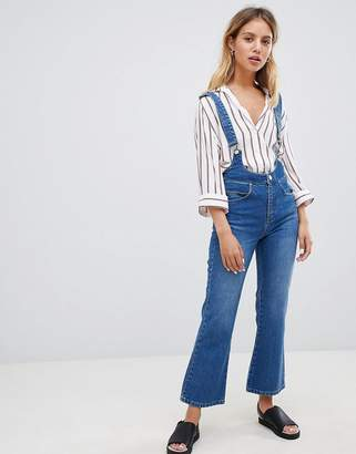 Asos DESIGN Egerton rigid cropped flare jeans in mid wash with suspenders