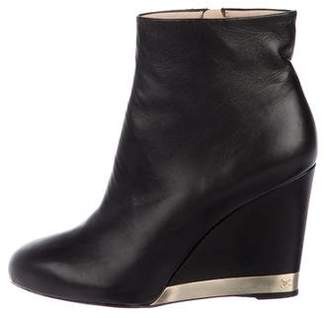 Chanel CC Wedge Boots
