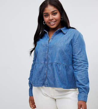 Asos DESIGN Curve denim shirt with ruffle hem in midwash blue