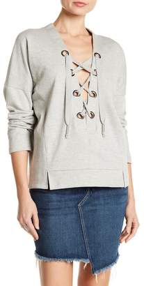 Romeo & Juliet Couture V-Neck Grommet Lace-Up Pullover