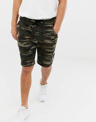Asos DESIGN skinny jersey shorts in camo print with MA1 pocket