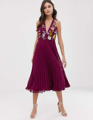 Asos DESIGN embroidered midi dress with halter neck and pleated skirt