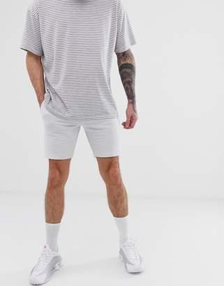 Asos Design DESIGN jersey skinny shorts in white marl