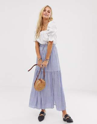 En Creme maxi skirt in gingham with thigh split and tie waist