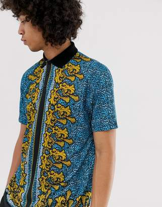 Asos DESIGN relaxed longline polo in blue leopard print with baroque border print