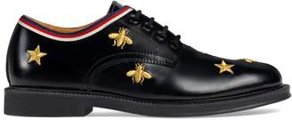 Gucci Children's bees and stars lace-up shoe