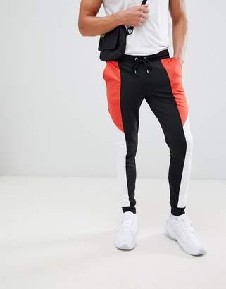 Asos DESIGN retro track super skinny joggers with color blocking