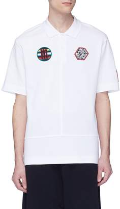 McQ Mix appliqué panelled polo shirt
