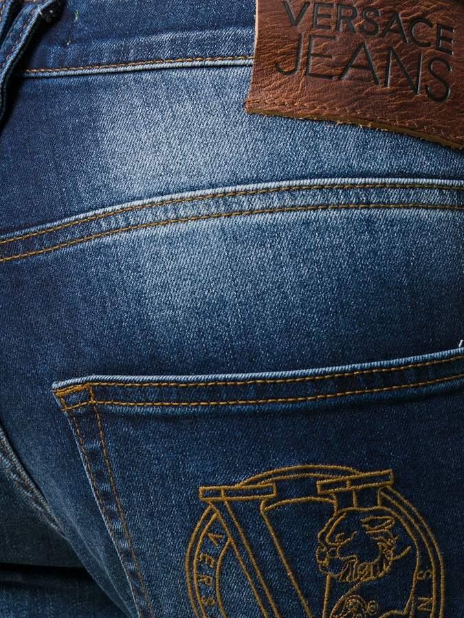 Versace distressed slim-fit jeans
