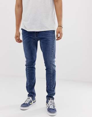Levi's Engineered twist hem slim tapered jeans in pagan mid wash