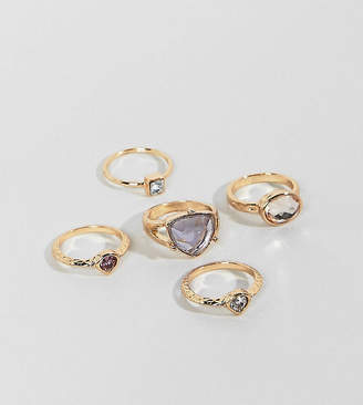 Monki multi colored pack rings in gold