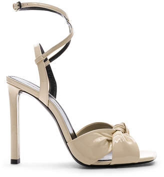 Saint Laurent Patent Amy Ankle Strap Sandals in Porcelain | FWRD