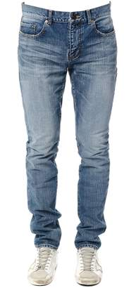 Saint Laurent Low Waisted Skinny Jean With Université Patch In Medium Blue Denim