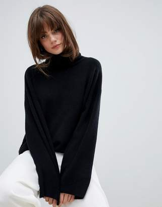 Asos DESIGN oversized slouchy roll neck sweater