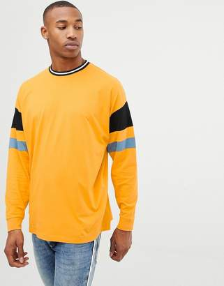 Asos DESIGN oversized longline long sleeve t-shirt with color blocking in yellow