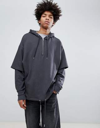 Asos DESIGN Oversized Hoodie With Drawstring Hem And Double Layer Sleeves In Washed Black