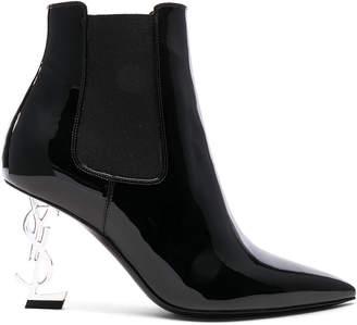 Saint Laurent Patent Opium Monogramme Heeled Boots in Black & Silver | FWRD