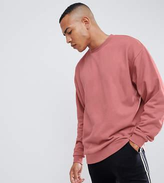Asos DESIGN tall oversized sweatshirt in pink