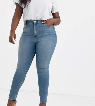 Asos DESIGN Curve Ridley high waisted skinny jeans in pretty mid stonewash blue