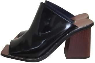 Celine Black Patent leather Mules & Clogs